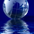Stock Photo: Blue globe with backlit light