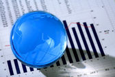 Diagram and glassy globe. — Stock Photo