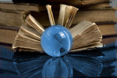 Glass globe and the old book — Stock Photo