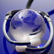Glass globe with stethoscope — Stock Photo
