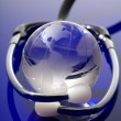 Glass globe with stethoscope — Stock Photo #2409690