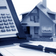 Stock Photo: Model house and calculator
