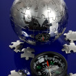 Stock Photo: Globe puzzle with compass