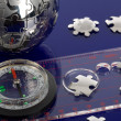 Globe puzzle with compass — Stock Photo