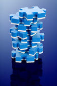 3D blue puzzle on blue background. — Stock Photo