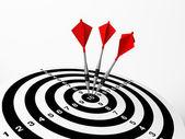 Three darts on bulls eye — Stock Photo