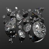 Diamonds jewel on black surface — Stock Photo