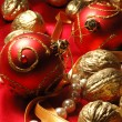 Red christmas balls and golden walnuts — Stockfoto
