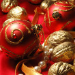 Red christmas balls and golden walnuts — Stock fotografie