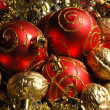 Stock Photo: Red christmas balls and golden walnuts