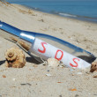 Message in a bottle with SOS signal — Stock Photo