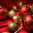 Red christmas balls and golden walnuts — 图库照片
