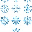 set van tien winter vector sneeuwvlokken — Stockvector