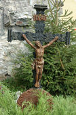 Old catholic cross on churchyard — Stock Photo