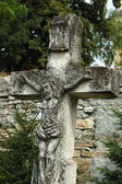 Old catholic cross on the churchyard — Stock Photo