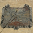Stock Photo: Old Sundial on ragged wall