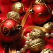 Red christmas balls and golden walnuts — Photo