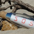 Message in a bottle with SOS signal — Stock Photo #1283557