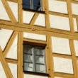 Two windows in half-timbered house — Stock Photo