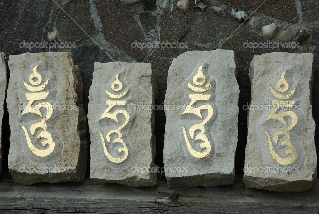 Four stones with sacred tibetan syllable — Stock Photo #1283976