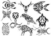 Set of vector tribal animal tattoos — Stock Vector