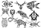 Set of vector tribal animal tattoos — Stock Vector