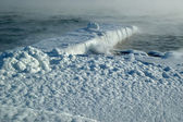 Steam over winter storm sea — Stock Photo