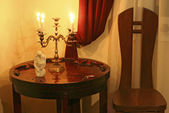 Candlestick in an interior — Stock Photo
