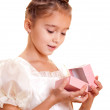 Little girl and gift — Stock Photo #1258247