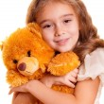 Little Girl And Teddy Bear — Stock Photo #1258550