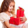 Little girl and gift — Stock Photo #1258620