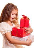 Little girl and gift — Stock Photo