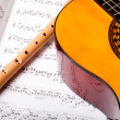 Stock Photo: Flute and acoustic guitar