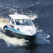 Speedboat cruising in the river Dnipro - Stock Photo