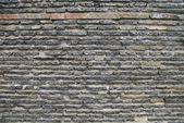 An aged brick wall — Stock Photo