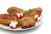 Meat rissoles with garden radish — Stock Photo