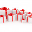 White gift box with big red holiday bow — Stock Photo