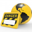 Signboard danger and a planet the earth - Stock Photo