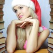 Sexual blonde in red hubcap with books — 图库照片