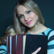Stock Photo: Beautiful blonde in sweater with books