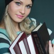 Beautiful blonde in sweater with books — Stock Photo #1055940