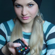 Beautiful blonde in black hat with board — Stock Photo
