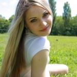 Beautiful blonde in wood — Stock Photo #1059901