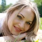 Beautiful blonde in wood — Stock Photo #1059926