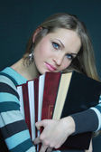 Sexual blonde in sweater with books — Stock Photo