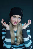 Beautiful blonde in black hat — Stock Photo