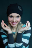 Sexual blonde in black hat — Stock Photo