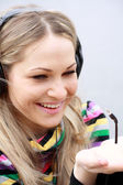 Blonde girl listens music — Stock Photo