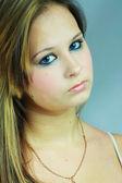 Beautiful young girl in white tanktop — Stock Photo
