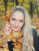 Beautiful and sexual blonde in forest — Stock Photo